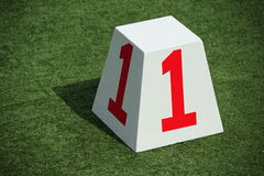 Number one sign,word. Sign attached to a white box with the number one on it Stock Image