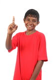 Number one signal from young smiling teenager boy Stock Photo
