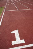 Number one signpost in an athletic running track Royalty Free Stock Image