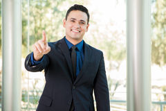 We are number one. Successful young businessman pointing out that his company is the number one and the leader Stock Photo