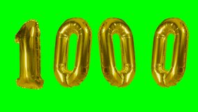 Number 1000 one thousand years birthday anniversary golden balloon floating on green screen -. Number 1000 one thousand years birthday anniversary golden balloon stock video