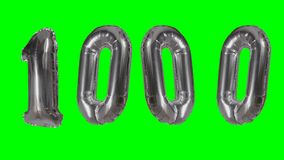 Number 1000 one thousand years birthday anniversary silver balloon floating on green screen -. Number 1000 one thousand years birthday anniversary silver balloon stock video footage