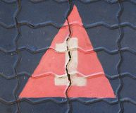 The number one in a triangle is on the footpath playground. This is the number one what has painted on bricks Stock Images