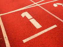 Free Number One. White Track Number On Red Rubber Racetrack Stock Photography - 80876042