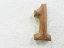Number one on white wall. Number one created by wood Stock Image