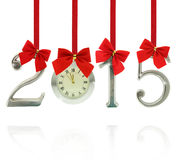 2015 number ornaments. With clock hanging on red ribbons Stock Image