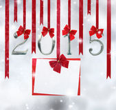 2015 number ornaments. And greeting card hanging on red ribbons Stock Photo