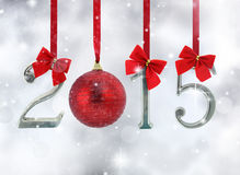 2015 number ornaments. Hanging on red ribbons in a glittery background royalty free illustration