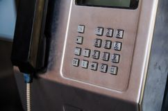 The number pad on a metal public pay phone. royalty free stock photo