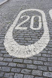 Number 20 painted on cobbled street in London, UK Stock Photos