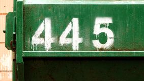Number 445 painted on the metal container stock photos