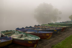 A number of the parked boats against the lake in fog Stock Image