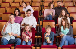 Number of people enjoying film screening and popcorn Stock Photography