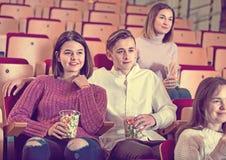 Number of people enjoying film screening and popcorn Royalty Free Stock Image