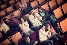 Number of people enjoying film screening and popcorn Royalty Free Stock Photo
