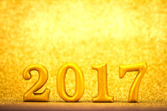 Number 2017 placed on gold elegant glamour background for new ye Stock Images