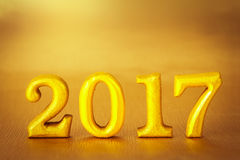 Number 2017 placed on gold elegant glamour background for new ye Royalty Free Stock Images