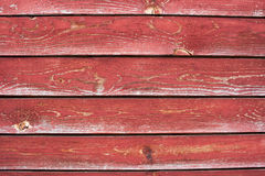 A number of  planks with cracked red paint Royalty Free Stock Images