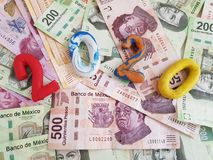 Number 2020 in plasticine colors, on mexican banknotes of various denominations. Textured background, backdrop for announcements of new year and money royalty free stock photography