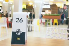 Number plate on table in McDonald`s. CHERKASY, UKRAINE – 14 October, 2018: number plate on table in McDonald`s. Waiting for order in the McDonald`s stock photography