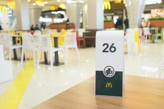 Number plate on table in McDonald`s. CHERKASY, UKRAINE – 14 October, 2018: number plate on table in McDonald`s. Waiting for order in the McDonald`s royalty free stock photo