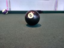 Number 8 pool ball on table royalty free stock photography