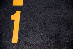 Number 1 position paint on asphalt road Stock Image
