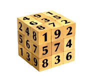 Number Puzzle Cube. Completed wooden puzzle number cube with numbers one to nine isolated on white background Stock Photography
