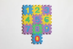 Number puzzle piece on white background. Number puzzle piece placed on white background stock photos