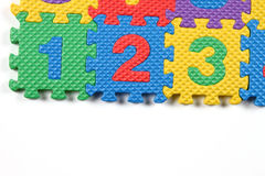 Number puzzles. Multi colored Number puzzles on white background stock illustration