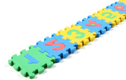 Number puzzles arranged in a row. Multi colored Number puzzles arranged in a row vector illustration