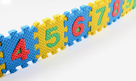Number puzzles arranged in a row Royalty Free Stock Photo