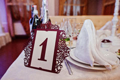 Number 1 on quests table at wedding party.  stock image