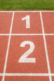 The 1 and 2 number on race track in football stadium. Stock Photo