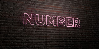 NUMBER -Realistic Neon Sign on Brick Wall background - 3D rendered royalty free stock image Stock Image