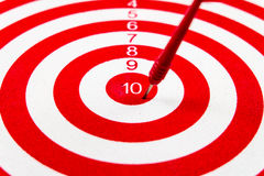Number 10 Red dart target with red arrows Stock Photo