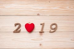 2019 number with red heart shape on wooden background, health, Insurance and New Year New You. Concept royalty free stock photo