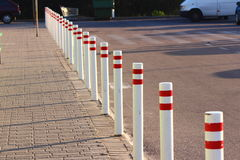 Number of restrictive columns. Along the road are restrictive bars white Royalty Free Stock Photo