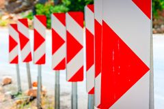 Number of road signs warning of dangerous turn Royalty Free Stock Images