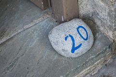 Number of the room on the big stone. In the Greece hotel stock photos