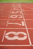Number in running track. Athletics stadium running track ruber standard red color stock photos