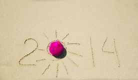 Number 2014 on the sand - holiday concept Royalty Free Stock Photos