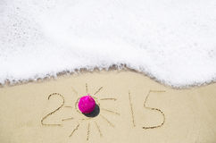Number 2015 on the sand - holiday concept Stock Image