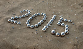 Number 2015 on the sand Stock Photo