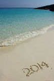 Number 2014 on the sandy beach Stock Photo