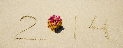 Number 2014 on sandy beach - holiday concept Royalty Free Stock Photos