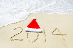 Number 2014 on sandy beach - holiday concept Royalty Free Stock Image