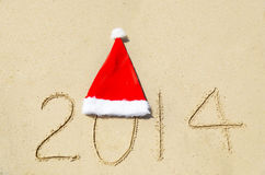 Number 2014 on sandy beach - holiday concept Stock Image
