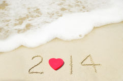 Number 2014 on sandy beach - holiday concept Stock Photo
