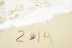 Number 2014 on sandy beach - holiday concept Stock Images